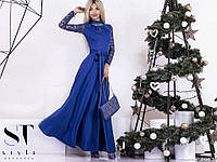 Элегантное вечернее платье в пол материал трикотаж и гипюр, горловина украшена брошью. Цвет синий