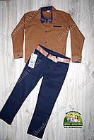 Стильный комплект для мальчика: коричневая рубашка и темно-синие брюки