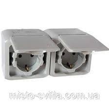 Розетка двойная с заземлением и защитными шторками 2К+З, IP44 серый Legrand Quteo 782394