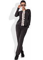 Стильный костюм из трикотажа с вертикальной рюшей