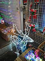Анимационный новогодний олень светящийся, который вращает головой