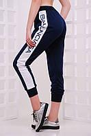 Женские брюки на манжетах с лампансами