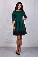 Красивое женское платье зеленого цвета