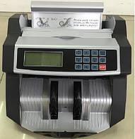 Устройство для подсчёта и проверки денег  2040