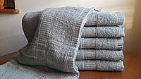 Лицевые однотонные махровые полотенца
