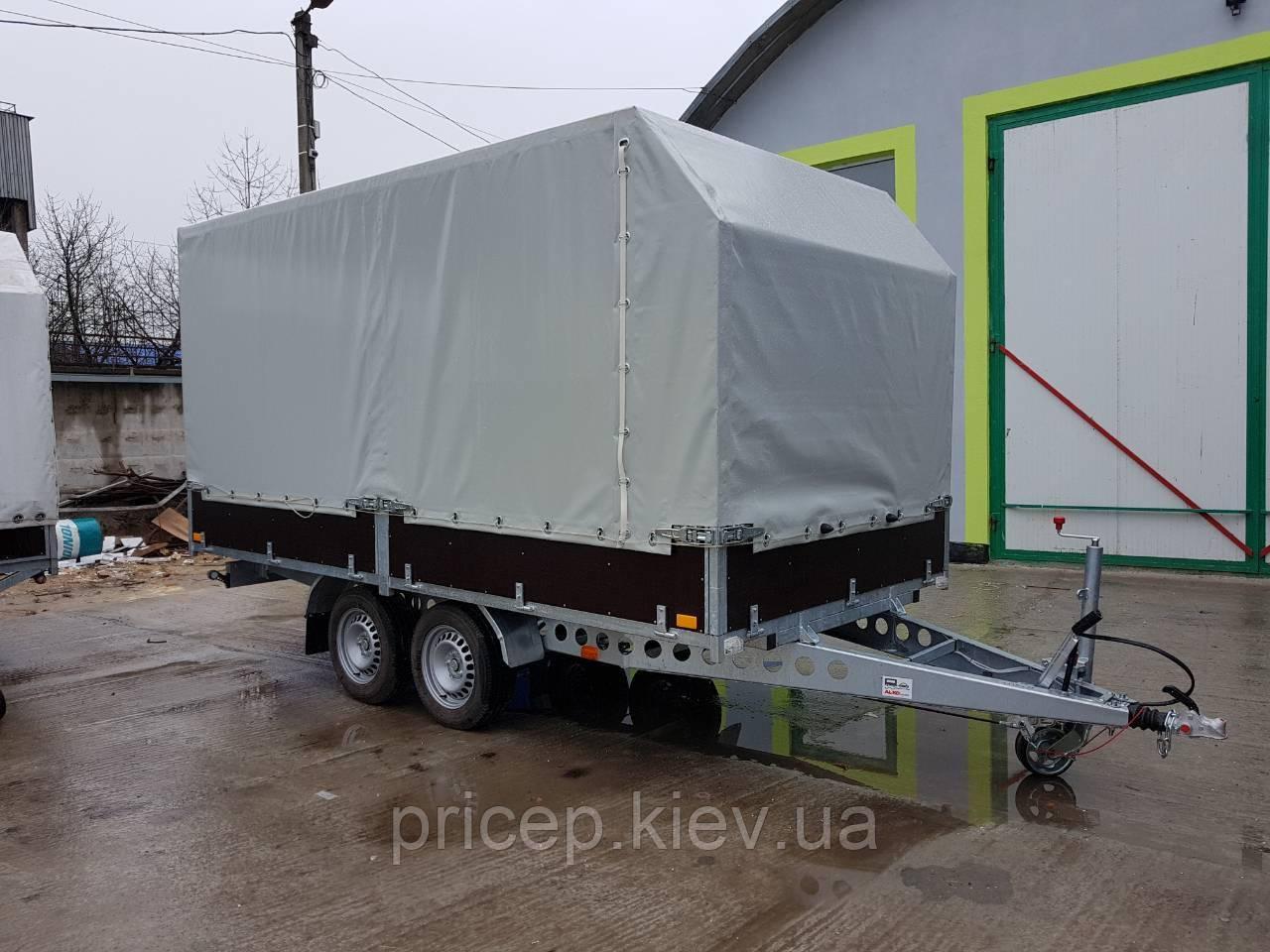 Причіп для перевезення негабаритних вантажів з бортами тентованый. Два гальмівних торсиона 1500кг.