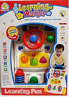 Детские ходунки. Игровой центр-каталка FS33875 Китай