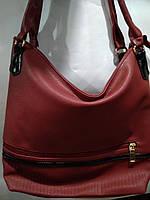 Очень вместительная женская сумка из искусственной кожи высокого качества.