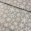 Ткань с густыми белыми снежинками на сером фоне, ширина 160