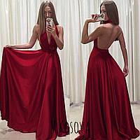 Женское вечернее платье с открытой спинкой выполнено из атласа