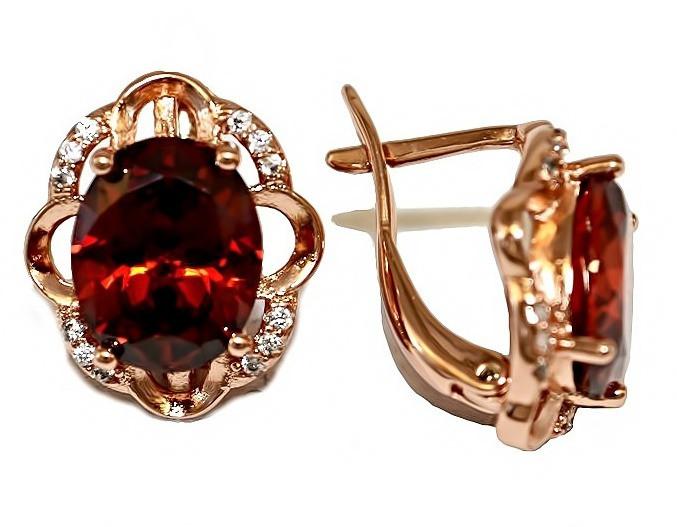 Серьги ХР позолота с красным оттенком.Камни: белый и бордовый циркон. Высота серьги 1,6 см.Ширина 13 мм.