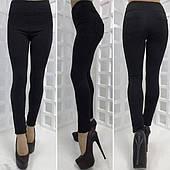 Теплі штани чорного кольору 42-54рр
