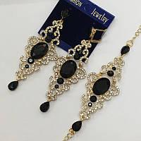 Набір прикрас Довгі ажурні сережки і браслет з чорним каменем в золотій оправі
