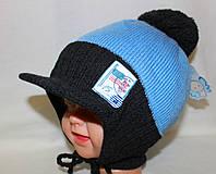 Вязаная шапочка с козырьком и завязками. Флис. 3-6 лет
