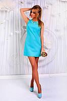 Стильное коротенькое платье с декоративной подвеской