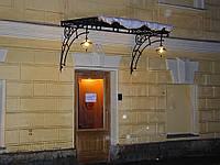 Козырек кованый над дверью
