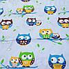 Ткань с разноцветными совами на веточке на голубом фоне, ширина 160 см