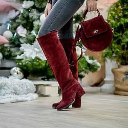 Круглая женская сумка из натуральной замши бордо.