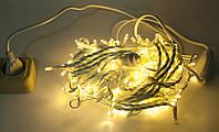 Гирлянда Уличная полу-профессиональная String 10м (Нить) 100 LED тепло белая с морганиям белый кабель